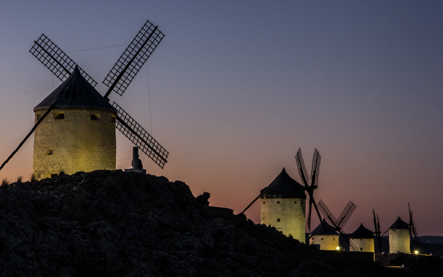 Fivewindmills in Consuegra during the night, on top of a hill with some ligting