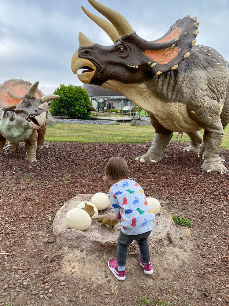 Girl playing with dinosaur egg replicas